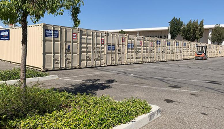 Mobile Mini Units lined up outside business for extra inventory space